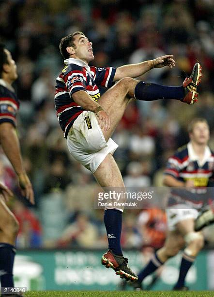 Brad Fittler of the Roosters kicks a high ball during the round 17 NRL match between the Sydney Roosters and the South Sydney Rabbitohs played at...