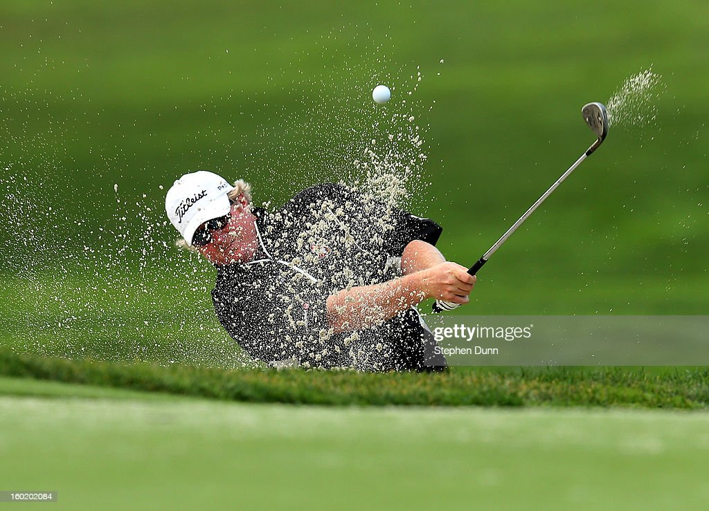 Brad Fritsch hits out of a bunker on the sixth hole during the third round of the Farmers Insurance Open on the South Course at Torrey Pines Golf Course on January 27, 2013 in La Jolla, California.