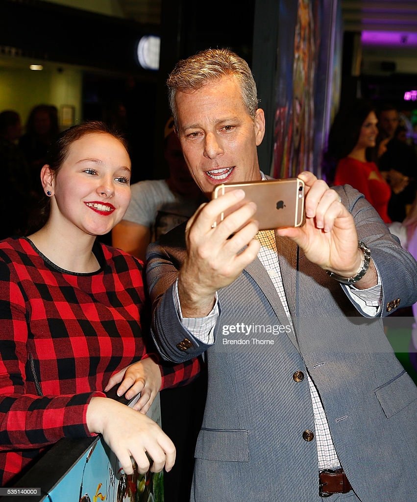 Brad Fuller poses with fans ahead of the Australian premiere of Teenage Mutant Ninja Turtles 2 at Event Cinemas George Street on May 29, 2016 in Sydney, Australia.