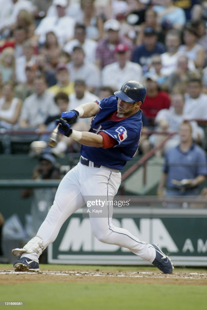 #20 <a gi-track='captionPersonalityLinkClicked' href=/galleries/search?phrase=Brad+Fullmer&family=editorial&specificpeople=220658 ng-click='$event.stopPropagation()'>Brad Fullmer</a>, Texas Rangers DH breaks up <a gi-track='captionPersonalityLinkClicked' href=/galleries/search?phrase=Miguel+Batista&family=editorial&specificpeople=215198 ng-click='$event.stopPropagation()'>Miguel Batista</a>'s shut out with a 7th inning solo home run. Texas Rangers sweep Toronto Blue Jays with a 7-5 come behind victory. Ameriquest Stadium, Arlington, Texas on July 18, 2004.