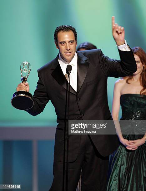 Brad Garrett winner Outstanding Supporting Actor in A Comedy Series with presenter Marcia Cross