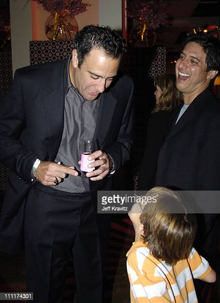 Brad Garrett with Ray Romano and son during 'Everybody Loves Raymond ' Wrap Party January 23 United States
