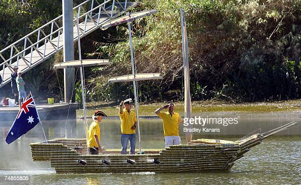 Brad Gillam salutes to bystanders as his boat made from beer cans begins a journey along the Brisbane River on June 22 2007 in Brisbane Australia...