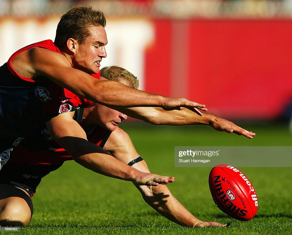 Brad Green of Melbourne attempts a mark in front of Sean Wellman of Essendon during the AFL Round two match between the Essendon Bombers and the...