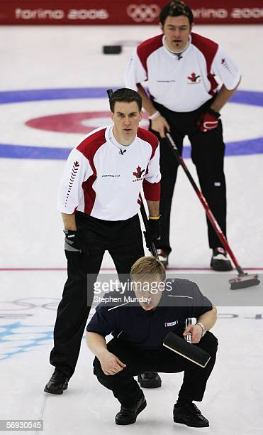 Brad Gushue Jamie Korab of Canada and Willie Makela of Finland all look on during the Gold medal match of the men's curling between Finland and...