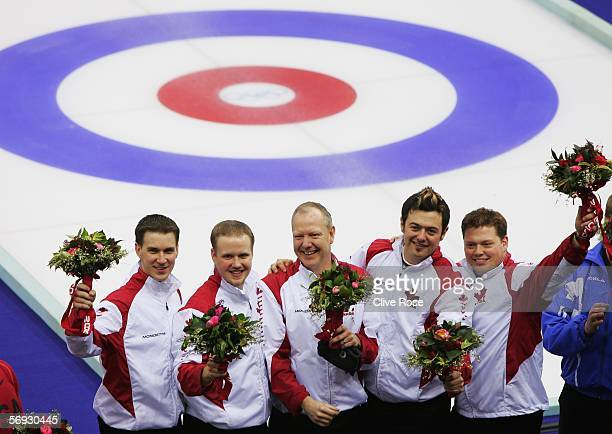 Brad Gushue Mark Nichols Russ Howard Jamie Korab and Mike Adam of Canada celebrate winning gold after the Gold medal match of the men's curling...