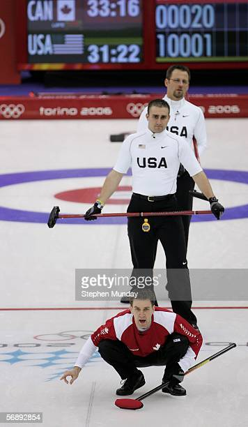 Brad Gushue of Canada shouts instructions watched by Joe Polo and Shawn Rojeski of the United States during the preliminary round of the men's...