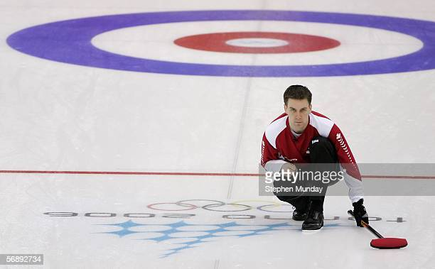 Brad Gushue of Canada watches the stone during the preliminary round of the men's curling between Canada v USA during Day 10 of the Turin 2006 Winter...