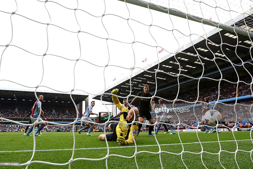 <a gi-track='captionPersonalityLinkClicked' href=/galleries/search?phrase=Brad+Guzan&family=editorial&specificpeople=662127 ng-click='$event.stopPropagation()'>Brad Guzan</a>, goalkeeper of Aston Villa sees the ball land in the back of the net as <a gi-track='captionPersonalityLinkClicked' href=/galleries/search?phrase=Yaya+Toure&family=editorial&specificpeople=550817 ng-click='$event.stopPropagation()'>Yaya Toure</a> of Manchester City scores his goal during the Barclays Premier League match between Aston Villa and Manchester City at Villa Park on September 28, 2013 in Birmingham, England.