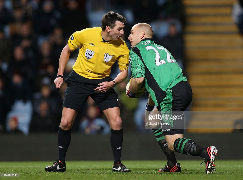 <a gi-track='captionPersonalityLinkClicked' href=/galleries/search?phrase=Brad+Guzan&family=editorial&specificpeople=662127 ng-click='$event.stopPropagation()'>Brad Guzan</a> of Aston Villa and Referee Lee Probert exchange words during the Barclays Premier league match between Aston Villa and Reading at Villa Park on November 27, 2012 in Birmingham, England.