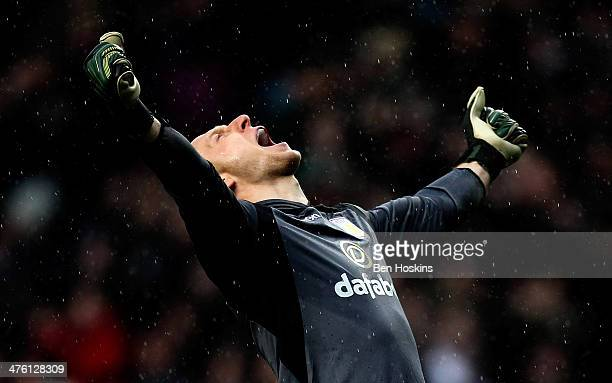 Brad Guzan of Aston Villa celebrates his team's third goal during the Barclays Premier League match between Aston Villa and Norwich City at Villa...