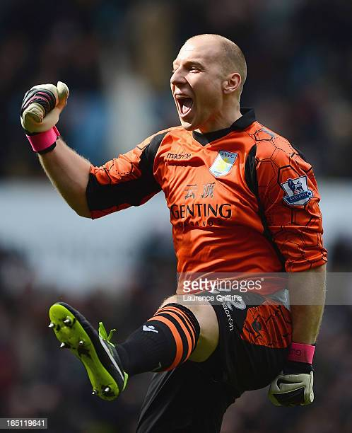 Brad Guzan of Aston Villa celebrates the opening goal during the Barclays Premier League match between Aston Villa and Liverpool at Villa Park on...