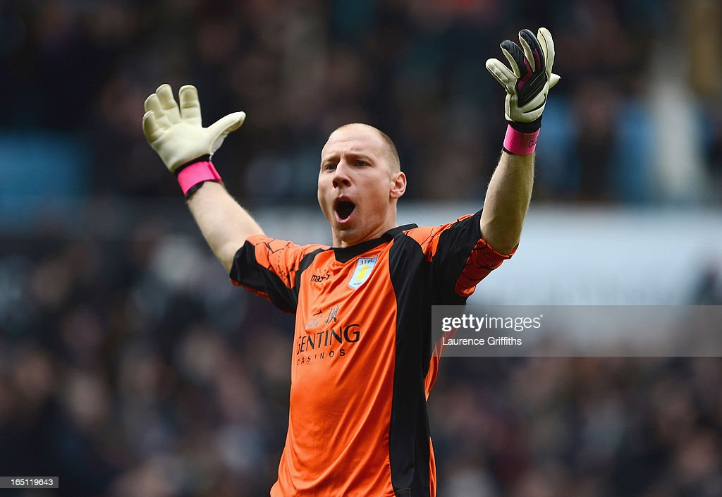 Brad Guzan of Aston Villa celebrates the opening goal during the Barclays Premier League match between Aston Villa and Liverpool at Villa Park on March 31, 2013 in Birmingham, England.