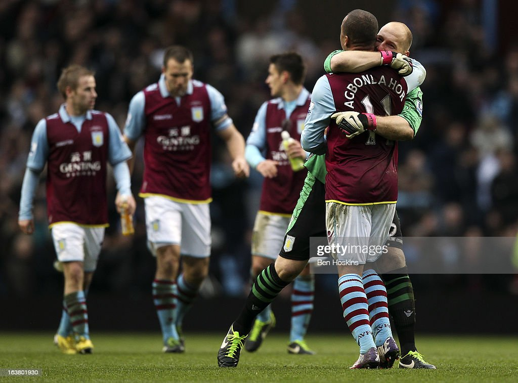 <a gi-track='captionPersonalityLinkClicked' href=/galleries/search?phrase=Brad+Guzan&family=editorial&specificpeople=662127 ng-click='$event.stopPropagation()'>Brad Guzan</a> of Aston Villa embraces team mate <a gi-track='captionPersonalityLinkClicked' href=/galleries/search?phrase=Gabriel+Agbonlahor&family=editorial&specificpeople=662025 ng-click='$event.stopPropagation()'>Gabriel Agbonlahor</a> after the final whistle during the Barclays Premier League match between Aston Villa and Queens Park Rangers at Villa Park on March 16, 2013 in Birmingham, England.
