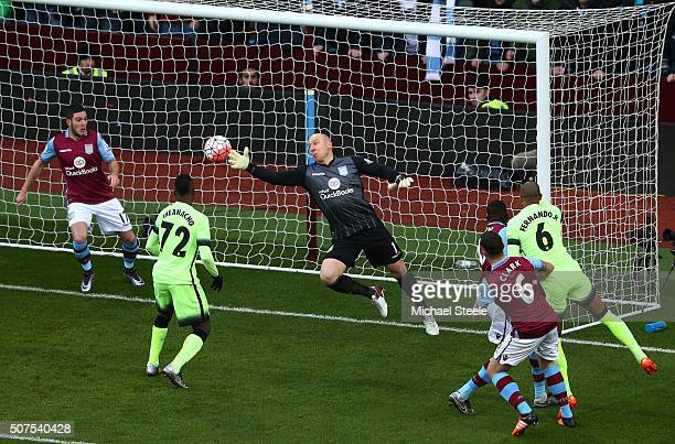 Brad Guzan of Aston Villa makes a save a shot by Fernando of Manchester City resulting in the Kelechi Iheanacho's first goal during the Emirates FA...