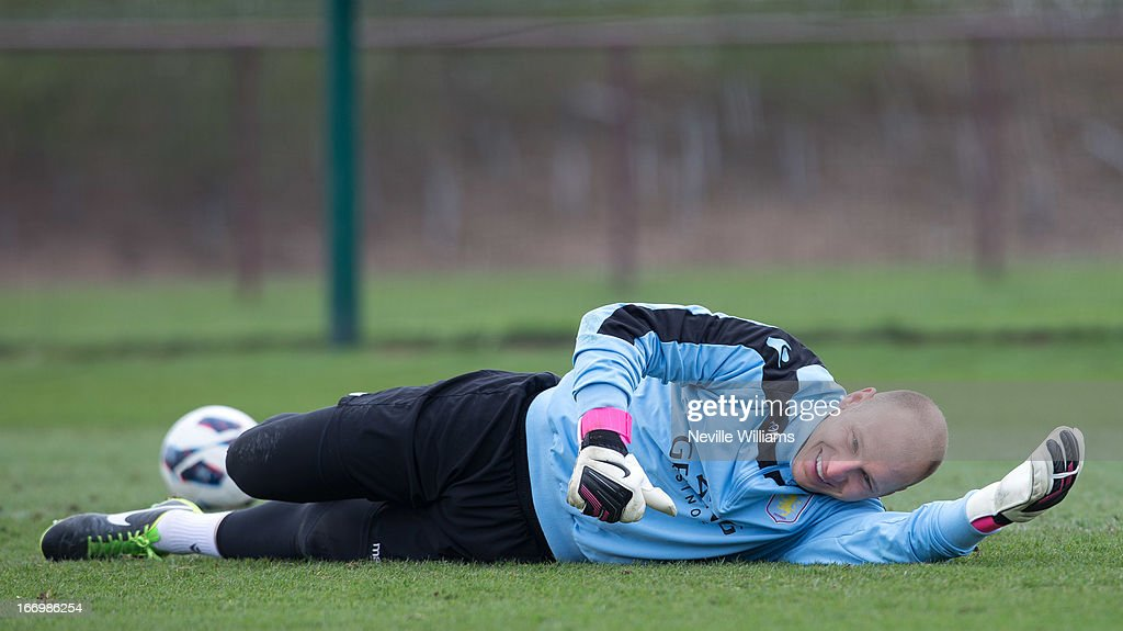 Brad Guzan of Aston Villa smiles as he lays on the pitch during a Aston Villa training session at the club's training ground, Bodymoor Heath on April 19, 2013 in Birmingham, England.