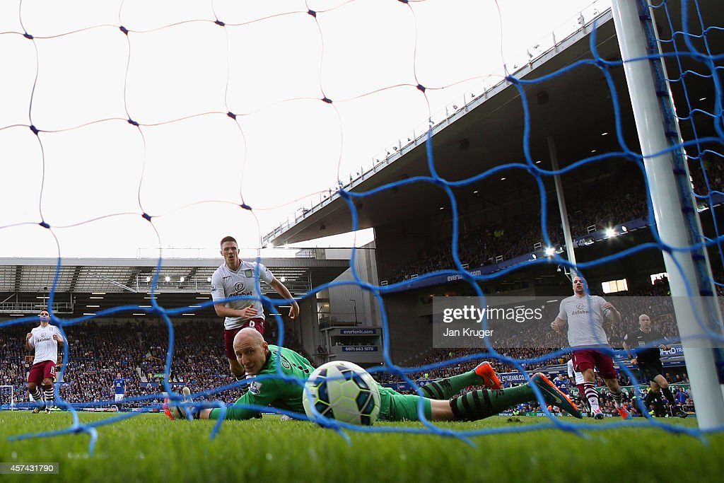 <a gi-track='captionPersonalityLinkClicked' href=/galleries/search?phrase=Brad+Guzan&family=editorial&specificpeople=662127 ng-click='$event.stopPropagation()'>Brad Guzan</a> of Aston Villa watches the ball as Romelu Lukaku of Everton (not pictured) scores their second goal during the Barclays Premier League match between Everton and Aston Villa at Goodison Park on October 18, 2014 in Liverpool, England.