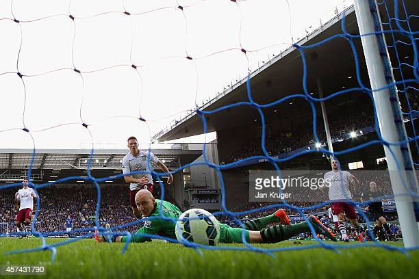 Brad Guzan of Aston Villa watches the ball as Romelu Lukaku of Everton scores their second goal during the Barclays Premier League match between...