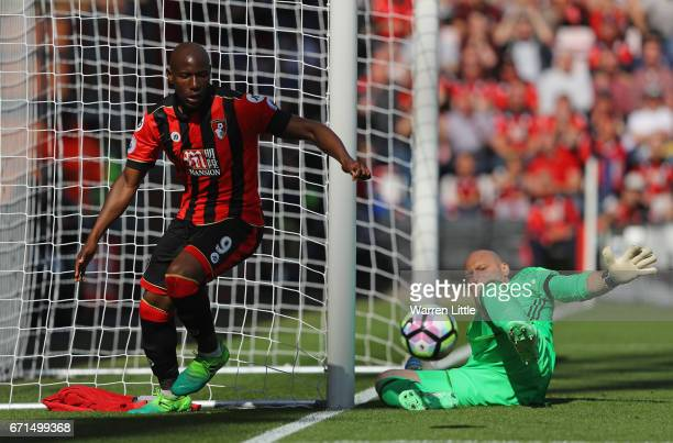 Brad Guzan of Middlesbrough looks on as Benik Afobe of AFC Bournemouth attempts to score during the Premier League match between AFC Bournemouth and...