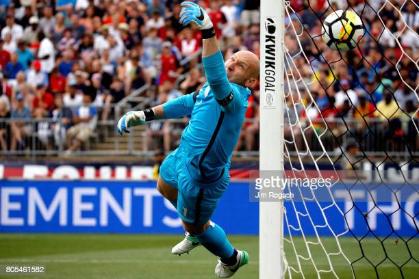 Brad Guzan of the United States allows a goal by Asamoah Gyan of Ghana in the second half during an international friendly between USA and Ghana at...