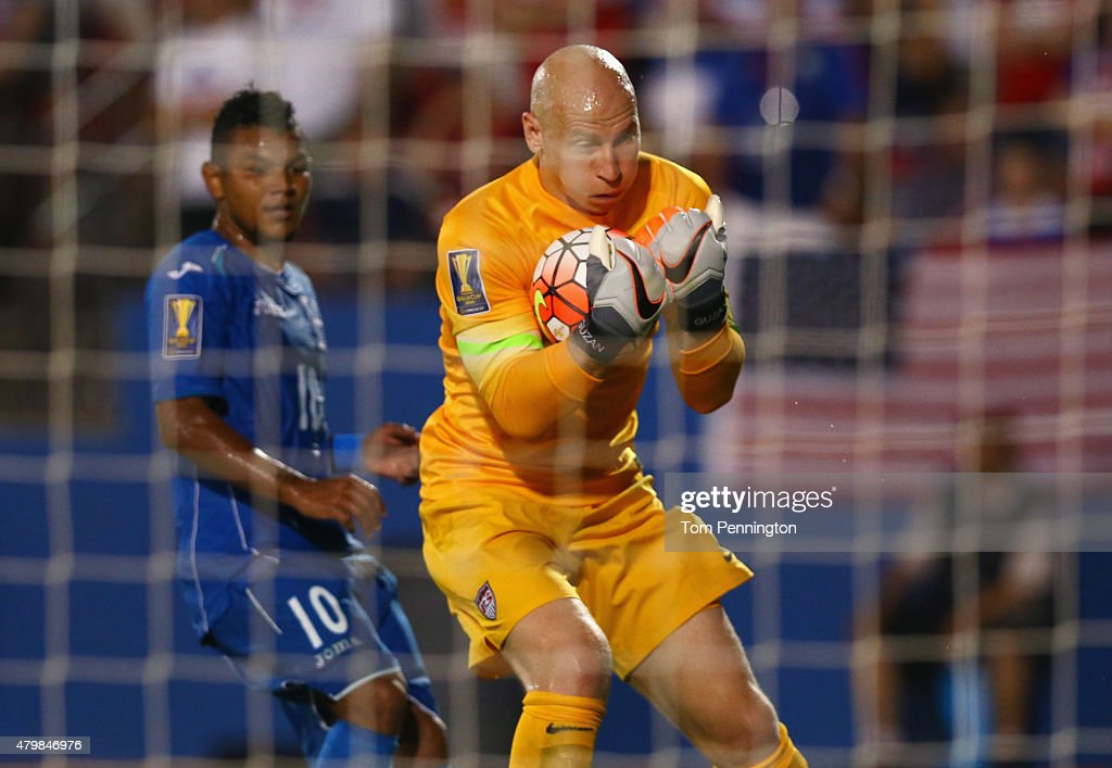 Brad Guzan #1 of the USA blocks a shot against Mario Martinez #10 of Honduras during the 2015 CONCACAF Gold Cup Group A match between USA and Honduras at Toyota Stadium on July 7, 2015 in Frisco, Texas.