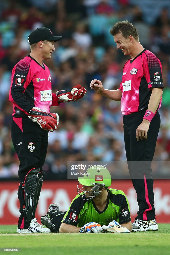 <a gi-track='captionPersonalityLinkClicked' href=/galleries/search?phrase=Brad+Haddin&family=editorial&specificpeople=193800 ng-click='$event.stopPropagation()'>Brad Haddin</a> and <a gi-track='captionPersonalityLinkClicked' href=/galleries/search?phrase=Brett+Lee&family=editorial&specificpeople=169885 ng-click='$event.stopPropagation()'>Brett Lee</a> of the Sixers share a laugh as Ryan Carters of the Thunder lies on the ground during the Big Bash League match between Sydney Thunder and the Sydney Sixers at ANZ Stadium on December 30, 2012 in Sydney, Australia.