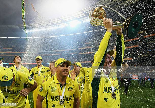Brad Haddin and David Warner of Australia celebrates with the trophy during the 2015 ICC Cricket World Cup final match between Australia and New...