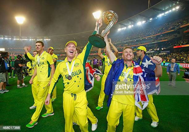 Brad Haddin and David Warner of Australia hold the World Cup trophy aloft as they celebrate winning the 2015 ICC Cricket World Cup final match...