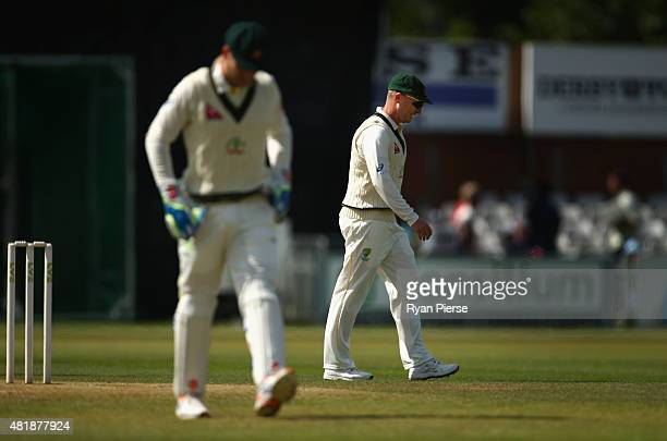 Brad Haddin and Peter Nevill of Australia field during day three of the Tour Match between Derbyshire and Australia at The 3aaa County Ground on July...