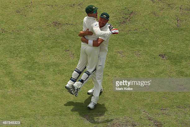Brad Haddin and Ryan Harris of Australia celebrate victory and a 30 series win during day five of the Third Ashes Test Match between Australia and...
