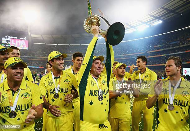 Brad Haddin celebrates with the trophy during the 2015 ICC Cricket World Cup final match between Australia and New Zealand at Melbourne Cricket...