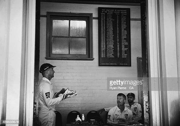 Brad Haddin David Warner and Nathan Lyon of New South Wales talk in the change rooms before day one of the Sheffield Shield match between New South...