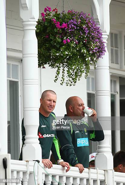 Brad Haddin of Australia and Australian coach Darren Lehmann looks on during day one of the 4th Investec Ashes Test match between England and...