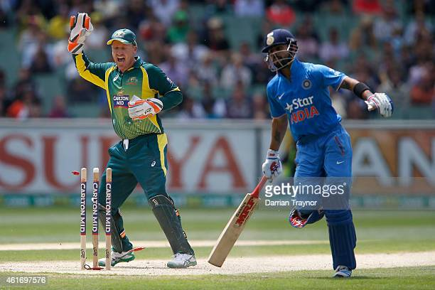 Brad Haddin of Australia appeals for a run out as Virat Kohli of India makes his ground during the One Day International match between Australia and...