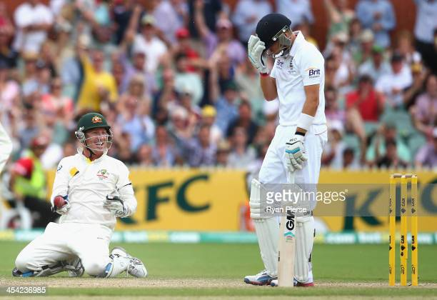 Brad Haddin of Australia celebrates after taking a catch to dismiss Joe Root of England off the bowling of Nathan Lyon of Australia during day four...