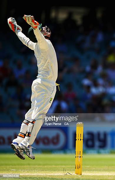 Brad Haddin of Australia celebrates after taking a catch to dismiss during day five of the First Test match between Cheteshwar Pujara of India...