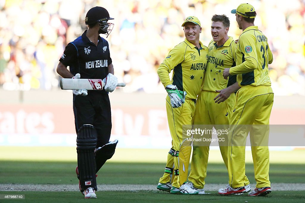 <a gi-track='captionPersonalityLinkClicked' href=/galleries/search?phrase=Brad+Haddin&family=editorial&specificpeople=193800 ng-click='$event.stopPropagation()'>Brad Haddin</a> of Australia (L) celebrates the wicket of <a gi-track='captionPersonalityLinkClicked' href=/galleries/search?phrase=Grant+Elliott&family=editorial&specificpeople=708027 ng-click='$event.stopPropagation()'>Grant Elliott</a> of New Zealand with <a gi-track='captionPersonalityLinkClicked' href=/galleries/search?phrase=James+Faulkner+-+Cricketer&family=editorial&specificpeople=11388189 ng-click='$event.stopPropagation()'>James Faulkner</a> (C) during the 2015 ICC Cricket World Cup final match between Australia and New Zealand at Melbourne Cricket Ground on March 29, 2015 in Melbourne, Australia.