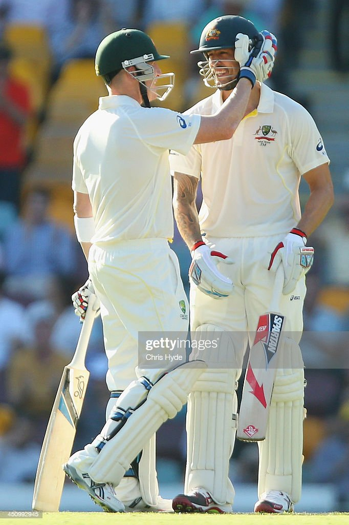 Brad Haddin of Australia congratulates team mate Mitchell Johnson after scoring his half century during day one of the First Ashes Test match between Australia and England at The Gabba on November 21, 2013 in Brisbane, Australia.