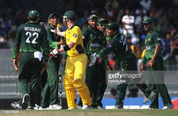 Brad Haddin of Australia exchanges words with Younis Khan of Pakistan and other Pakistan players during the 2011 ICC World Cup Group A match between...