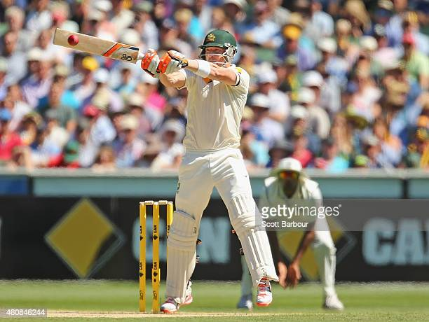 Brad Haddin of Australia faces a short pitched delivery as he hits a boundary during day two of the Third Test match between Australia and India at...