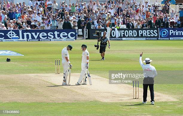 Brad Haddin of Australia is given out by umpire Aleem Dar as he stands with team mate James Pattinson which went to a referral for the final wicket...