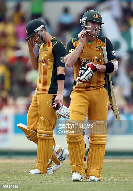 Brad Haddin of Australia leaves the field after being dismissed as Michael Clarke looks on during the ICC World Twenty20 semi final between Australia...