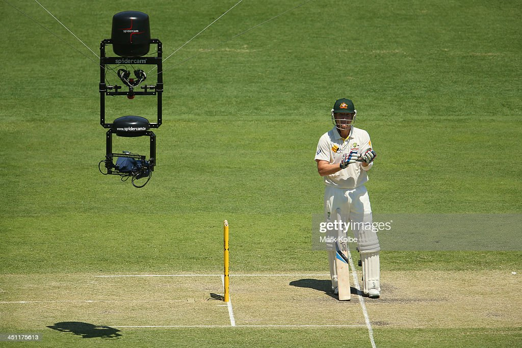 Brad Haddin of Australia looks at the Spidercam as he prepares to bat during day two of the First Ashes Test match between Australia and England at...