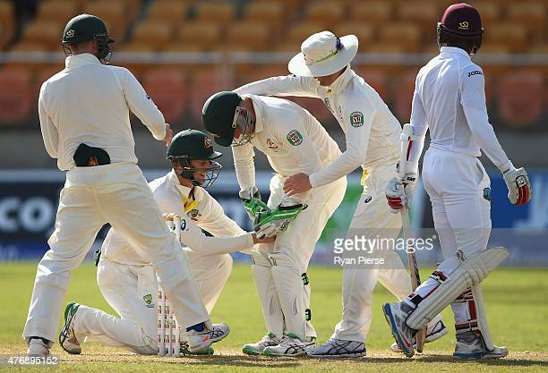 Brad Haddin of Australia takes a catch between his legs to dismiss Shai Hope of West Indies off the bowling of Nathan Lyon of Australia during day...