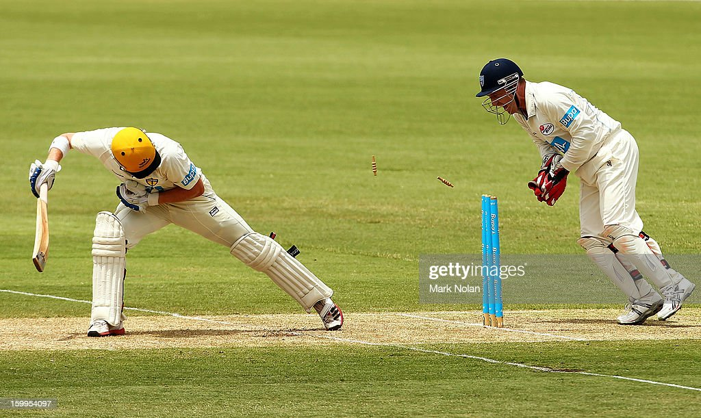 <a gi-track='captionPersonalityLinkClicked' href=/galleries/search?phrase=Brad+Haddin&family=editorial&specificpeople=193800 ng-click='$event.stopPropagation()'>Brad Haddin</a> of the Blues attempts to stump John Rogers of the Warriors during day one of the Sheffield Shield match between the New South Wales Blues and the Western Australia Warriors at Blacktown International Sportspark on January 24, 2013 in Sydney, Australia.