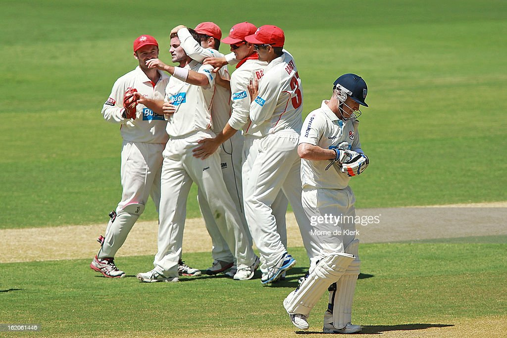 <a gi-track='captionPersonalityLinkClicked' href=/galleries/search?phrase=Brad+Haddin&family=editorial&specificpeople=193800 ng-click='$event.stopPropagation()'>Brad Haddin</a> (R) of the Blues leaves the field after getting out as Redbacks players celebrate getting him out during day one of the Sheffield Shield match between the South Australian Redbacks and the New South Wales Blues at Adelaide Oval on February 19, 2013 in Adelaide, Australia.