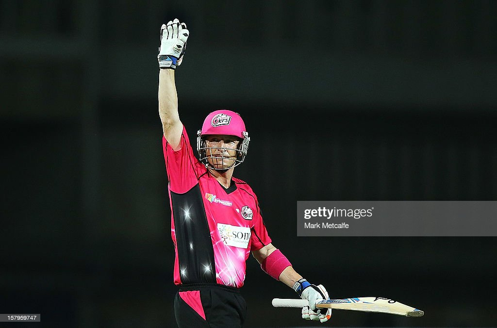 <a gi-track='captionPersonalityLinkClicked' href=/galleries/search?phrase=Brad+Haddin&family=editorial&specificpeople=193800 ng-click='$event.stopPropagation()'>Brad Haddin</a> of the Sixers acknowledges the crowd after scoring his half century during the Big Bash League match between the Sydney Sixers and the Sydney Thunder at Sydney Cricket Ground on December 8, 2012 in Sydney, Australia.