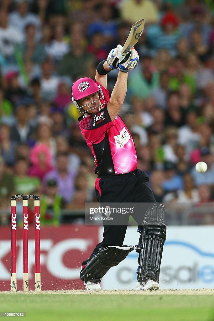 <a gi-track='captionPersonalityLinkClicked' href=/galleries/search?phrase=Brad+Haddin&family=editorial&specificpeople=193800 ng-click='$event.stopPropagation()'>Brad Haddin</a> of the Sixers bats during the Big Bash League match between Sydney Thunder and the Sydney Sixers at ANZ Stadium on December 30, 2012 in Sydney, Australia.