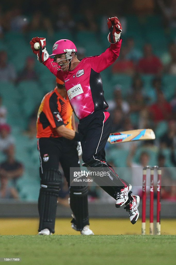 <a gi-track='captionPersonalityLinkClicked' href=/galleries/search?phrase=Brad+Haddin&family=editorial&specificpeople=193800 ng-click='$event.stopPropagation()'>Brad Haddin</a> of the Sixers celebrates the wicket of Marcus North of the Scorchers during the Big Bash League match between the Sydney Sixers and the Perth Scorchers at SCG on December 16, 2012 in Sydney, Australia.