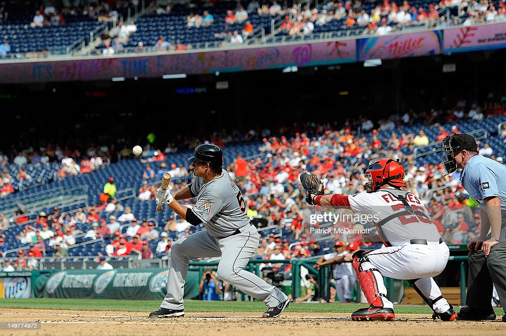 <a gi-track='captionPersonalityLinkClicked' href=/galleries/search?phrase=Brad+Hand&family=editorial&specificpeople=7551554 ng-click='$event.stopPropagation()'>Brad Hand</a> #52 of the Miami Marlins bunts against the Washington Nationals in the second inning at Nationals Park on August 3, 2012 in Washington, DC.